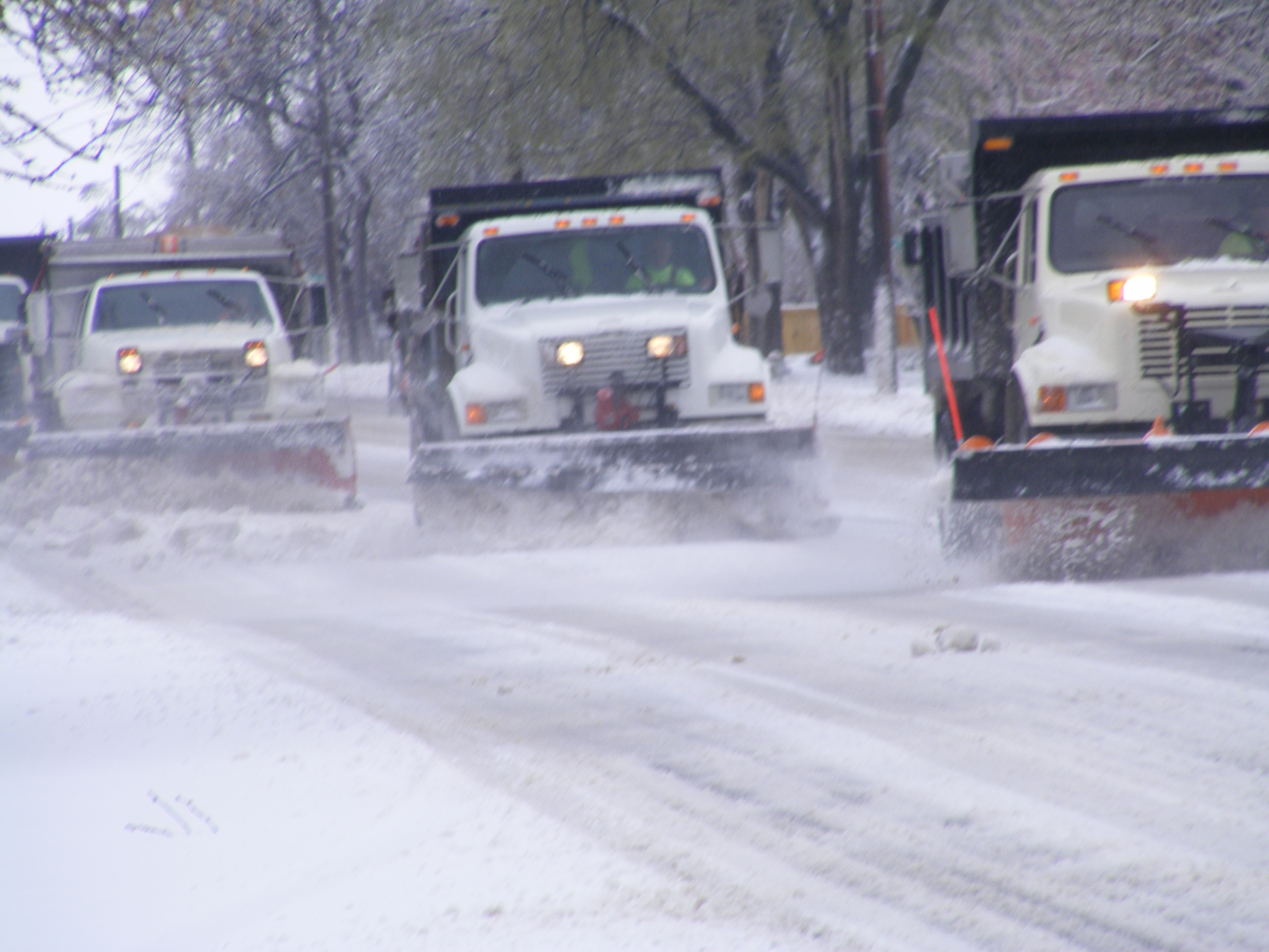 3 Snow Plow Truck on the Street