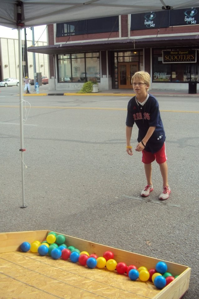 Boy Playing Ball Toss